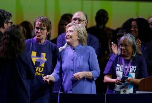 Democratic presidential candidate Hillary Clinton meets with Service Employees International Union (SEIU) members at the union's 2016 International Convention, Monday, May 23, 2016, in Detroit. At left is union president Mary Kay Henry. (AP Photo/Carlos Osorio)