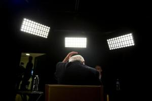 Democratic presidential candidate Sen. Bernie Sanders, I-Vt., fixes his hair before an interview with The Associated Press, Monday, May 23, 2016, in Los Angeles. (AP Photo/Jae C. Hong)