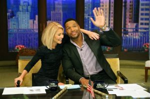 "In this image released by Disney ABC Home Entertainment and Television Distribution, co-hosts Kelly Ripa, left, and Michael Strahan appear during the production of ""Live! With Kelly and Michael"" on Strahan's final day as co-host, Friday, May 13, 2016, in New York. (David M. Russell/Disney ABC Home Entertainment and Television Distribution via AP)"