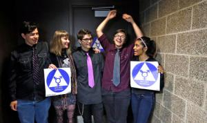 Destin Cramer, second right, embraces friends from the school's Gender Awareness Group as they pose for a photo at the opening of a gender neutral bathroom at Nathan Hale high school Tuesday, May 17, 2016, in Seattle. From left are Jakob Ainsworth, Honour Beattie, Zack Bebout, Cramer and Deena Kennedy. President Obama's directive ordering schools to accommodate transgender students has been controversial in some places but since 2012 Seattle has mandated that transgender students be able to use of the bathrooms and locker rooms of their choice. Nearly half of the district's 15 high schools already have gender neutral bathrooms and one high school has had a transgender bathroom for 20 years. (AP Photo/Elaine Thompson)