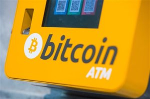 File - This is a Oct. 16, 2015 file photo of a  Bitcoin ATM. An Australian man long thought to be associated with the digital currency Bitcoin has publicly identified himself as its creator. BBC News said Monday, May 2, 2016 that Craig Wright told the media outlet he is the man previously known by the pseudonym Satoshi Nakamoto. The computer scientist, inventor and academic says he launched the currency in 2009 with the help of others. (Dominic Lipinski/PA via AP, File) UNITED KINGDOM OUT NO SALES NO ARCHIVE