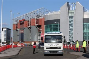 In this photo taken on Sunday, May 15, 2016, a police bomb squad unit leaves Old Trafford stadium after the final soccer match of the season between Manchester United and AFC Bournemouth was abandoned due to a suspect package being found inside the stadium. Greater Manchester's interim mayor has called for an inquiry into a security alert triggered by a fake bomb left behind at a sports stadium after a training exercise. The discovery of the dummy bomb on Sunday prompted the evacuation of Manchester United's stadium, Old Trafford. Police say the bomb discovered in a toilet just before kickoff had been left by a private company after a drill using search dogs. (Martin Rickett/PA via AP) UNITED KINGDOM OUT    -    NO SALES   -   NO ARCHIVES