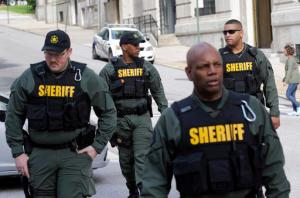 Members of the Baltimore City Sheriff's Office walk outside a courthouse before a verdict in the trial of Officer Edward Nero, one of six Baltimore city police officers charged in connection to the death of Freddie Gray, in Baltimore, Monday, May 23, 2016. (AP Photo/Patrick Semansky)