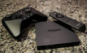 FILE - This Sept. 29, 2014, file photo, shows the Amazon Fire TV, a product for streaming popular video services, apps and games in high-definition, in Decatur, Ga. To use Sony's PlayStation Vue, you need a PlayStation or Amazon Fire TV gadget and have to live in one of seven big cities, or their suburbs. Dish's Sling TV and Sony's PlayStation Vue both offer ways to watch traditional TV channels over the Internet without a cable box or satellite dish. (AP Photo/Ron Harris, File)