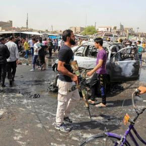 The Latest: Officials say day's death toll in Baghdad now69