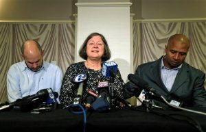 FILE - In this April 9, 2013, file photo, former NFL player Dorsey Levens, right, extends a hand as Mary Ann Easterling, the widow of former NFL player Ray Easterling, reacts as former NFL player Kevin Turner, left, looks down during a news conference in Philadelphia, after a hearing to determine whether the NFL faces years of litigation over concussion-related brain injuries. A federal appeals court has upheld an estimated $1 billion plan by the NFL to settle thousands of concussion lawsuits filed by former players, potentially ending a troubled chapter in league history.The decision released Monday, April 18, 2016, comes nearly a year after a district judge approved a revised deal that lifted the initial $765 million cap and weeks after an NFL official speaking to Congress acknowledged for the first time a link between football and CTE. (AP Photo/Matt Rourke, File)
