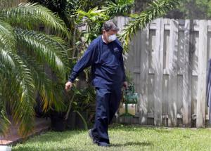 In this photo taken April 12, 2016, Giraldo Carratala, an inspector with the Miami- Dade County, Fla. mosquito control unit, sprays pesticide in the yard of a home in Miami, Fla. Beg, borrow and steal: Zika preparation involves a bit of all three as federal, state and local health officials try to get a jump on the mosquito-borne virus while Congress haggles over how much money they really need. With the money in limbo, it's all about shifting resources. (AP Photo/Lynne Sladky)