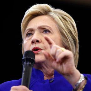 History in hand, Clinton faces voters as presumptive nominee