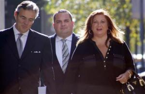 """FILE - In this Nov. 2, 2015, file photo, Abigale Lee Miller, right, from the TV reality show """"Dance Moms,"""" arrives with her attorneys for a hearing before a federal magistrate in Pittsburgh. Miller plans to accept responsibility for federal charges filed in Pittsburgh accusing her of failing to report Australian currency she brought into the country in 2014 and bankruptcy fraud charges, she said in a statement Tuesday, June 21, 2016. (AP Photo/Keith Srakocic, File)"""
