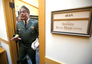 File - In this July 10, 2015 file photo, San Francisco Sheriff Ross Mirkarimi leaves after speaking at a news conference where he provided information regarding the release of Juan Francisco Lopez-Sanchez in San Francisco. The parents of a woman killed on a San Francisco pier by a man in the country illegally is suing the city and two federal agencies that they say contributed to her death. Kate Steinle's parents filed the wrongful-death lawsuit Friday, May 27, 2016. It accuses the San Francisco Sheriff's Department of failing to notify federal immigration officials that it was releasing Juan Francisco Lopez-Sanchez from jail. (AP Photo/Tony Avelar, File)