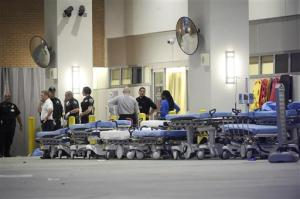 FILE - In this June 12, 2016 file photo, emergency personnel wait with stretchers at the emergency entrance to Orlando Regional Medical Center hospital for the arrival of patients from the scene of a fatal shooting at Pulse Orlando nightclub in Orlando, Fla. Up to 1 in 5 deaths from car crashes, gunshots or other injuries might be prevented with better, quicker trauma care that doesn't depend so much on where you live, according to government advisers _ advice that takes on new urgency amid the increasing threat of mass casualties like the massacre in Orlando. (AP Photo/Phelan M. Ebenhack, File)