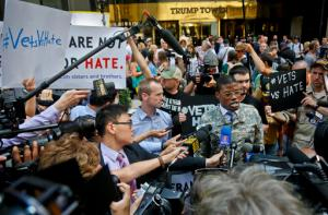 "U.S. Army vet Claude Copeland, center, ""is joined by veterans, as he speaks during a press briefing outside a Donald Trump news conference, Tuesday May 31, 2016, in New York. ""We stand against anyone who is using hate rhetoric in regard to representing veterans,"" said Copeland. Following sustained pressure from media outlets, Trump announced Tuesday, May 31, 2016, the charities that have received millions of dollars from a veterans' fundraiser he held earlier this year. (AP Photo/Bebeto Matthews)"