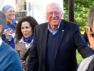 Democratic presidential candidate Sen. Bernie Sanders, I-Vt., arrives at City Hall Park in Burlington, Vt., on Monday, June 13, 2016. Sanders took park during a march and vigil for the people killed and wounded during a shooting at an Orlando, nightclub. (AP Photo/Wilson Ring)