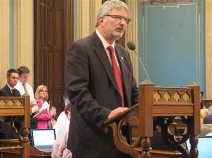 Sen. Goeff Hansen, a Hart Republican, speaks against a main bill in a $617 million bailout and restructuring of Detroit's school district in the Senate chamber on Wednesday, June 8, 2016, in Lansing, Mich. Hansen, a key bill sponsor who helped shepherd an earlier bipartisan plan through the Senate, said he fears the GOP-written legislation going to Gov. Rick Snyder is inadequate. (AP Photo/David Eggert)