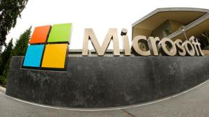 FILE - This July 3, 2014, file photo, shows the Microsoft Corp. logo outside the Microsoft Visitor Center in Redmond, Wash. Microsoft said Monday, June 13, 2016, it is buying professional networking service site LinkedIn for about $26.2 billion. LinkedIn, based in Mountain View, Calif., has more than 430 million members. (AP Photo Ted S. Warren, File)
