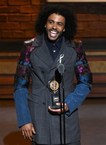 "Daveed Diggs accepts the award for featured actor in a musical for ""Hamilton"" at the Tony Awards at the Beacon Theatre on Sunday, June 12, 2016, in New York. (Photo by Evan Agostini/Invision/AP)"