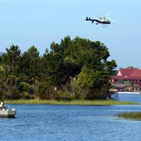 Authorities search for boy dragged into water by gator