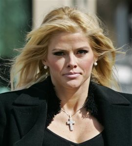 FILE - In this Feb. 28, 2006 file photo, Anna Nicole Smith, leaves the U.S. Supreme Court in Washington. The former Playboy Playmate and reality TV star accidentally overdosed on at least nine prescription drugs in February 2007. She had been taking chloral hydrate, a seldom-prescribed sedative. An autopsy report says she sometimes drank the sedative directly from the bottle. (AP Photo/Manuel Balce Ceneta, File)