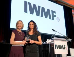Judy Woodruff, left, presents Kenya-based freelance photographer Adriane Ohanesian with the Anja Niedringhaus Courage in Photojournalism Award, Thursday, June 9, 2016 in Washington. The annual award was first given in 2015. It goes to a female photographer whose life and work honor Niedringhaus' legacy. (AP Photo/Alex Brandon)