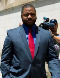 Officer William Porter, one of six Baltimore city police officers charged in connection to the death of Freddie Gray, leaves the courthouse after testifying in the trial of Officer Caesar Goodson, Monday, June 13, 2016, in Baltimore. Goodson, the wagon driver facing second-degree murder, manslaughter and other charges stemming from the death of Freddie Gray. Porter's trial in the Gray case ended in mistrial. He will be tried again in September. (AP Photo/Jose Luis Magana)