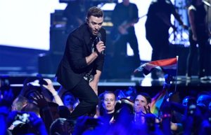 "FILE - In this May 14, 2016, file photo, U.S. singer Justin Timberlake performs  during the Eurovision Song Contest final in Stockholm, Sweden. If Spotify's predictions are correct, Timberlake's ""Can't Stop the Feeling"" will be a summer song you can't stop singing. The streaming music service revealed Thursday, June 2, 2016, its picks for the songs likely to be unavoidable this season (AP Photo/Martin Meissner, File)"