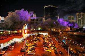 Smoke covers the area after The Monaco Tower at the Riviera Hotel and Casino crumbled to the ground during a controlled demolition, Tuesday, June 14, 2016, in Las Vegas. The casino opened in 1955 and was closed last year to make room to expand the Las Vegas Convention Center. (AP Photo/John Locher)