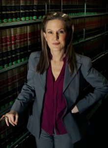 """FILE- This Wednesday, March 14, 2012 photo shows attorney Wendy Murphy in the law library at the New England School of Law in Boston. As colleges nationwide face increasing pressure to aggressively investigate reports of sex assaults, some advocates think they've found a way to restore what they say is much-needed balance between the rights of the accuser and the accused. Their target: a """"Dear Colleague Letter"""" issued by the U.S. Department of Education's Office of Civil Rights in 2011 that laid out specific requirements for dealing with sexual violence under Title IX, a federal civil rights law that prohibits sex discrimination in education. (AP Photo/Elise Amendola, File)"""