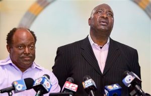 Terry Banks, right, speaks about his nephew, Corey Jones, next to Bishop Thomas Masters during a news conference at the Bible Church of God in Boynton Beach, Fla., Wednesday, June 1, 2016. Fired officer Nouman Raja was arrested Wednesday and charged with attempted murder and manslaughter in the Oct. 18, 2015, death of Jones, after a grand jury found the shooting was unjustified. (Greg Lovett/Palm Beach Post via AP)  MAGS OUT; TV OUT; NO SALES; MANDATORY CREDIT