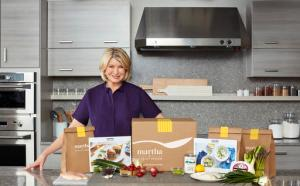 In this photo provided by Marley Spoon, Inc., Martha Stewart poses with ingredients from a meal kit. Cooking like Stewart is about to get easier, as the home goods mogul and cookbook author is getting into the fast-growing meal kit business. Subscribers of the meal kits will be shipped a box to their doors with Stewart's recipes and all the ingredients needed to cook up the dishes at home, including pre-measured raw meat, fish, vegetables and spices. The new venture is a licensing deal with existing meal kit company Marley Spoon and brand management company Sequential Brands Group Inc., which bought Martha Stewart Living Omnimedia in 2015. (Marcus Nilsson/Courtesy of Marley Spoon, Inc. via AP) MANDATORY CREDIT