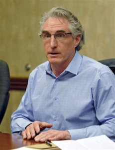 FILE - In this May 10, 2016, file photo, North Dakota Republican gubernatorial hopeful Doug Burgum speaks during an editorial board meeting in Bismarck. North Dakota Republicans nominated former Microsoft executive Burgum Tuesday, June 14, 2016, in a primary likely to decide the next governor, and voters also overwhelmingly rejected the Legislature's move to loosen the state's Depression-era rules prohibiting corporate farming. (Tom Stromme/The Bismarck Tribune via AP, File)  MANDATORY CREDIT