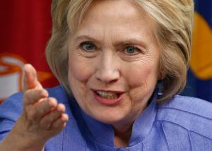CORRECTS LOCATION TO VIRGINIA AIR AND SPACE CENTER FROM VIRGINIA AIR AND SPACE MUSEUM  - Democratic Presidential candidate Hillary Clinton gestures during a panel discussion on national security, Wednesday, June 15, 2016, at the Virginia Air and Space Center in Hampton, Va. (AP Photo/Steve Helber)