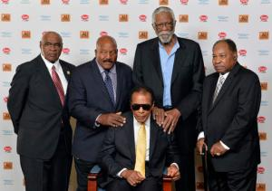 FILE - In this Sept. 27, 2014, file photo, back row from left, John Wooten, Jim Brown, Bill Russell, and Bobby Mitchell stand behind Muhammad Ali before the start of the Ali Humanitarian Awards ceremony in Louisville, Ky. The death of Muhammad Ali left a profound effect on many, even fellow legends.  (AP Photo/Timothy D. Easley, File)