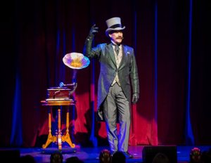"""This undated image released by DKC Public Relations shows Mark Kalin during a performance of """"he Illusionists: Turn of the Century."""" The magic show  is coming back to Broadway for a new holiday show celebrating the tricks and mood of the Golden Age of Magic, from 1903-1927. (Asia Live Network/DKC Public Relations via AP)"""