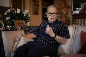 Three-time best sound-track Oscar winner Ennio Morricone answers questions during an interview with The Associated Press, in Rome, Tuesday, May 31, 2016. Oscar-winning composer is back on his feet after canceling a string of concerts because of a collapsed vertebrae that raised questions about the continued prodigious output of the 87-year-old legend. (AP Photo/Andrew Medichini)