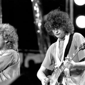 Led Zeppelin's Page dodges court questions, riffs airguitar