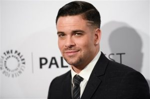 "FILE - In this March 13, 2015 file photo, Mark Salling arrives at the 32nd Annual Paleyfest ""Glee"" held at The Dolby Theatre in Los Angeles. Salling, an actor who starred on the musical dramedy ""Glee"" is scheduled to turn himself in to federal authorities Friday, June 3, 2016, in a child pornography case. Salling, who played bad-boy Noah ""Puck"" Puckerman on the series, is scheduled to be arraigned on two charges of receiving and possessing child pornography. (Photo by Richard Shotwell/Invision/AP, File)"