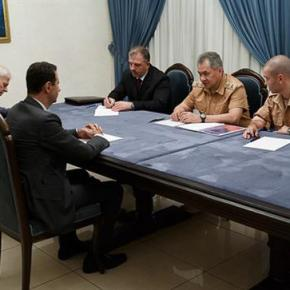 Russia's defense minister visits Syria, meets Assad