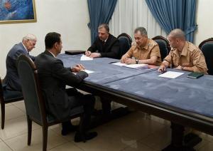 Russia's defense minister visits Syria, meets Assad