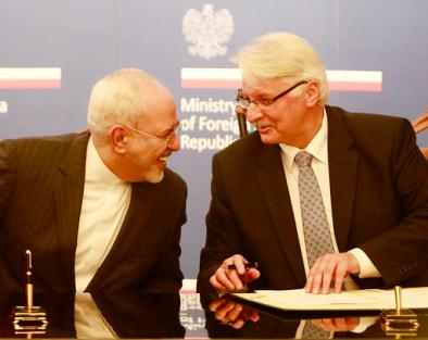 Polish Foreign Minister Witold Waszczykowski, right, talks with Iran's Foreign Minister Mohammad Javad Zarif during their meeting in Warsaw, Poland, Sunday, May 29, 2016. (AP Photo/Czarek Sokolowski)