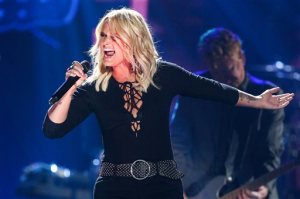 FILE - In a Saturday, April 30, 2016 file photo, Miranda Lambert performs during the 2016 iHeartRadio Country Festival held at Frank Erwin Center, in Austin, Texas. Lambert announced Wednesday, May 25, 2016, that she is closing her Pink Pistol clothing boutique in Tishomingo, Ok., where she and her ex-husband, Blake Shelton, once shared a home. She says Pink Pistol will reopen later this summer in her hometown of Lindale, Texas. (Photo by John Salangsang/Invision/AP, File)