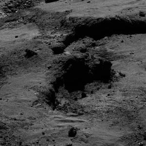 The May 21, 2016 photo released by the European Space Agency ESA shows the surface of Comet 67P/Churyumov-Gerasimenko. The photo was taken by the the OSIRIS narrow angle camera of the Rosetta space probe from a distance of 7.440 km from the comet. Scientists say they have detected glycine and phosphorus in the dusty envelope around a comet, supporting the theory that comets 'delivered' key chemicals necessary for the emergence of life on Earth. (ESA/Rosetta/MPS for OSIRIS Team  via AP)