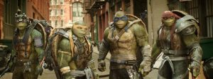 """This image released by Paramount Pictures shows, from left, Donatello, Michelangelo, Leonardo and Raphael in a scene from """"Teenage Mutant Ninja Turtles: Out of the Shadows."""" The movie opened to $35.3 million according to comScore estimates Sunday, June 5, 2016, close to half of what the first film opened to in 2014. (Lula Carvalho/Paramount Pictures via AP)"""