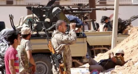 This image Tuesday, June 14, 2016 made from Associated Press video shows, Armed Misrata fighters loyal to the unity government on the main street of Sirte. A Libyan hospital spokesman says many pro-government fighters have been killed and tens wounded in latest fighting for the Islamic State group's bastion of Sirte. Libyan forces loyal to the unity government have been waging an offensive since last month to dislodge the militants from the coastal city. (AP Video via AP)