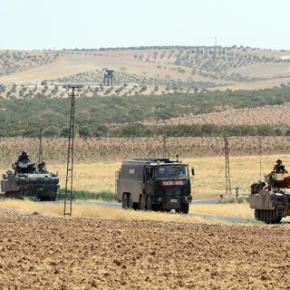 The Latest: US calls on Turkey, Syria Kurds to haltclashes