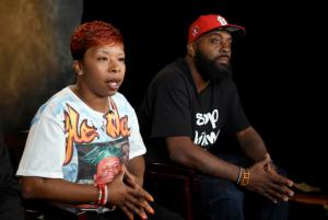 FILE - In this Sept. 27, 2014, file photo, the parents of Michael Brown, Lesley McSpadden, left, and Michael Brown, Sr., sit for an interview with The Associated Press in Washington. Defense attorneys in the wrongful-death lawsuit by Michael Brown's parents cite recent ambushes of police in Texas and Louisiana among reasons against expanding who can see sensitive grand jury details related to Brown's Ferguson 2014 death. (AP Photo/Susan Walsh, File)