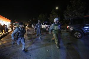 """Afghan security forces rush to respond to a complex Taliban attack on the campus of the American University in the Afghan capital Kabul on Wednesday, Aug. 24, 2016. """"We are trying to assess the situation,"""" President Mark English told The Associated Press. (AP Photo/Rahmat Gul)"""