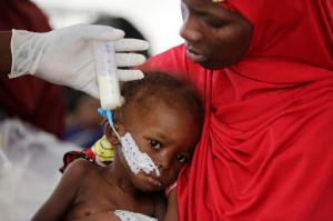 A doctor feeds a malnourished child at a feeding centre run by Doctors Without Borders in Maiduguri Nigeria, Monday Aug. 29, 2016. Children who escaped Boko Haram's Islamic insurgency now are dying of starvation in refugee camps in northeastern Nigeria's largest city as the government investigates the theft of food aid by officials. ( AP Photo/Sunday Alamba)
