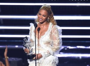 "Beyonce accepts the award for Video of the Year for ""Lemonade"" at the MTV Video Music Awards at Madison Square Garden on Sunday, Aug. 28, 2016, in New York. (Photo by Charles Sykes/Invision/AP)"