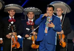 FILE - In this April 28, 2016, file photo, Mexican singer Juan Gabriel performs during the Latin Billboard Awards in Coral Gables, Fla. Representatives of Juan Gabriel have reported Sunday, Aug. 28, 2016, that he has died. Gabriel was Mexico's leading singer-songwriter and top-selling artist with sales of more than 100 million albums. The statement says he died Sunday, but did not say where. (AP Photo/Wilfredo Lee, File)