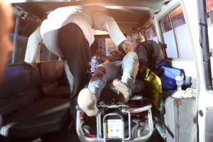 """A wounded person is treated in an ambulance after a complex Taliban attack on the campus of the American University in the Afghan capital Kabul on Wednesday, Aug. 24, 2016. """"We are trying to assess the situation,"""" President Mark English told The Associated Press. (AP Photo/Rahmat Gul)"""